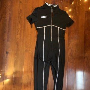 Black white detail half zip full body jumpsuit